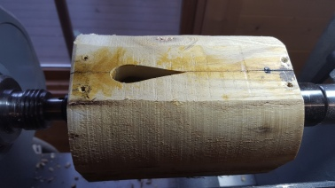 13. Now turn the log into a cylinder